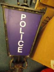 Police lamp awaiting a permanent home in the stores